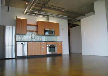 The kitchens and open spaces at the Loft 495 Kits apartment condos in Vancouver are truly impressive