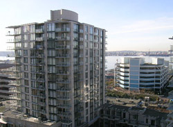 The concrete and glass Lower Lonsdale Time Condo buildings are located along the waterfront real estate district of North Vancouver